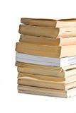 книги закрывают изолировано штабелируют вверх Стоковые Изображения RF