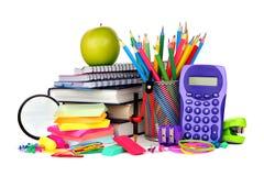 Книги и школьные принадлежности изолированные на белизне Стоковые Изображения