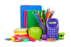 Книги и школьные принадлежности на белизне Стоковое Фото