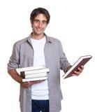 книги предпосылки голубые держа над детенышами студента Стоковое Изображение