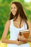 книги удерживания Женщин-студента стоковые изображения