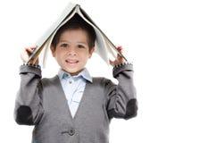 Книги чтения мальчика совместно на белой предпосылке Стоковое Изображение