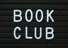 Книжный клуб фразы в белом тексте на доске письма стоковое фото rf