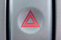 Кнопка в автомобиле для предупреждения когда аварийная остановка стоковая фотография rf