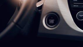 Кнопка двигателя автомобиля стартстопная современного автомобиля в интерьере стоковое фото rf