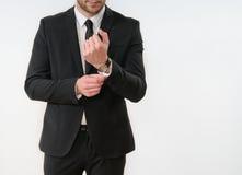 Кнопка стороны тела бизнесмена вверх по его черному костюму на белом backgro Стоковая Фотография RF