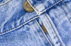 кнопки брюк джинсовой ткани закрывают вверх Стоковые Фото