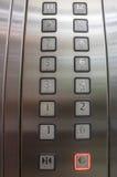 Кнопки в лифте, одном до 12 Стоковое Изображение
