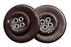 Кнопки кроют кожей на белой предпосылке Стоковое Фото