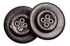 Кнопки кроют кожей на белой предпосылке Стоковые Фото