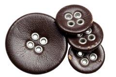Кнопки кроют кожей на белой предпосылке Стоковая Фотография