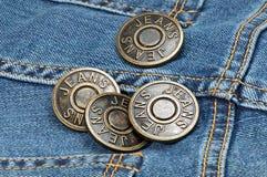 Кнопки металла джинсов на джинсовой ткани Стоковое фото RF