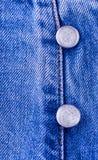Кнопки металла на голубых джинсах Стоковое Изображение RF