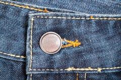 Кнопки на голубых джинсах Стоковая Фотография RF