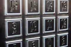 Кнопки полов на панели в лифте Стоковое фото RF