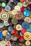 Кнопки для предпосылки одежд Стоковые Изображения