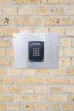 Кнопочная панель на кирпичной стене Стоковые Фото
