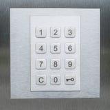 Кнопочная панель, номера и ключевое smbol - система безопасности двери Стоковая Фотография