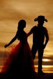 Ковбой и женщина силуэта в платье Стоковые Изображения RF
