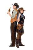 Ковбой и пастушка с оружи стоковые фото