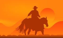 ковбой над заходом солнца Стоковое Изображение RF