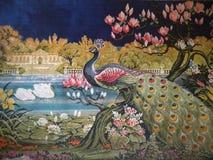 Ковер с павлином и лебедями стоковые фото