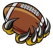 Коготь изверга животный держа шарик американского футбола иллюстрация штока