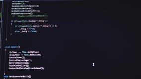 Код вебсайта на мониторе компьютера Программист на работе 3840x2160 акции видеоматериалы