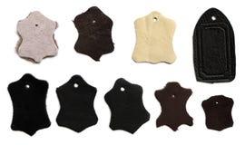 Кожаная бирка как символ качественных естественных загорая продуктов Стоковое Изображение