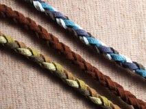 Кожаная веревочка на ткани ткани Стоковое фото RF