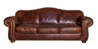 Кожаная коричневая изолированная софа Стоковые Фото