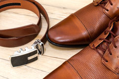Кожаные ботинки и пояс Стоковое фото RF