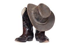 Кожаные ботинки и шлем ковбоя стоковые фотографии rf