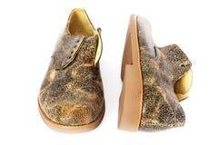 Кожаные ботинки на белой предпосылке стоковое фото rf