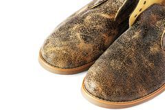 Кожаные ботинки на белой предпосылке стоковые изображения