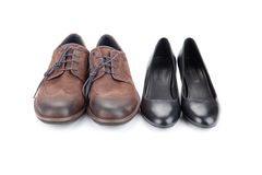 Кожаные ботинки для людей и женщин Стоковое Изображение