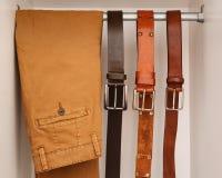 Кожаные поясы и брюки стоковое фото rf