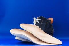 Кожаные протезные insoles с ботинком background card congratulation invitation Стоковые Изображения RF
