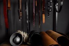 Кожаные ремни на шкафе около стены Стоковое Изображение RF