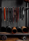 Кожаные ремни на шкафе около стены Стоковая Фотография RF