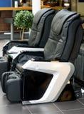 Кожаные удобные стулья массажа Стоковое Изображение