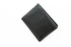 Кожаные черные деньги бумажника на предпосылке Стоковые Изображения