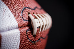 Кожаный американский футбол на черной предпосылке Стоковое Изображение