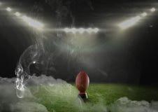 кожаный шарик американского футбола в стадионе Стоковое Изображение