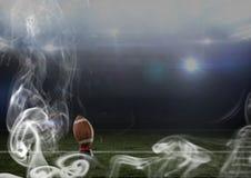 кожаный шарик американского футбола в стадионе Стоковое фото RF