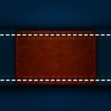 Кожаный ярлык зашитый к джинсам Стоковые Изображения RF