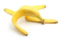 Кожа банана на белизне Стоковые Фото