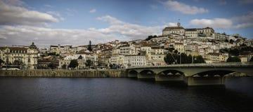 Коимбра, Португалия с мостом Европы Стоковые Изображения