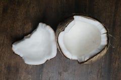 Кокос на деревянном столе Стоковые Фото