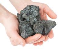 Кокс угля в руке на белой предпосылке Стоковая Фотография